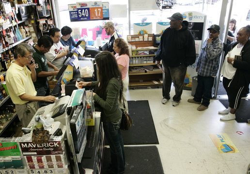 People who waited in a long line at Bluebird Liquor purchase Mega Millions lottery tickets for Friday's drawing that has surpassed a jackpot of over $540 million, in Lawndale, California
