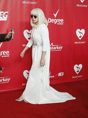 Singer Lady Gaga poses at the 2014 MusiCares Person of the Year gala honoring Carole King in Los Angeles