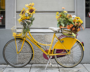 Yellow Bike Covered with Flowers