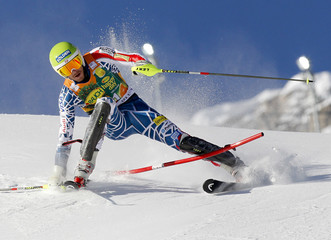 Bode Miller of the U.S. misses a gate during the first leg of the men's World Cup slalom skiing race in Val d'Isere