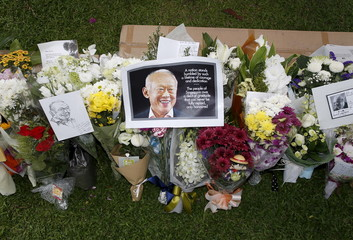 Flowers are placed in tribute to the late former prime minister Lee Kuan Yew outside the Parliament House in Singapore