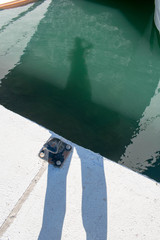 the shadow of me taking a photograph in my local port in Marbella, Spain
