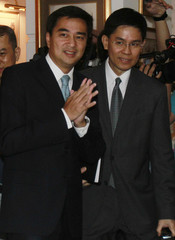 Thailand's Prime Minister Abhisit Vejjajiva arrives at a hotel in Bangkok