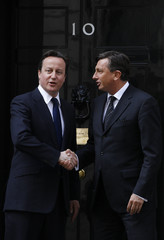 Britain's Prime Minister David Cameron bids farewell to his Slovenian counterpart Borut Pahor, at number 10 Downing Street in London