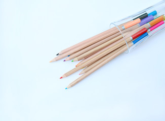 A stack of colored pencils on white background.