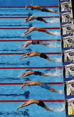 Swimmers start the men's 200m backstroke semi-final during the World Swimming Championships at the Sant Jordi arena in Barcelona