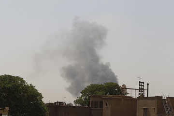 Smoke rises from the site of a car bomb attack in Baghdad