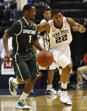 Michigan State's Lucas and Penn State's Jones chase the basketball during a men's Big Ten tournament game in Indianapolis.