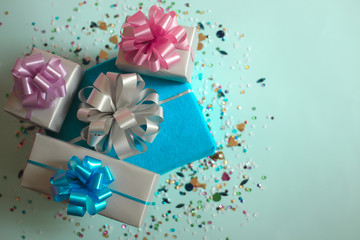 The gift boxes on a blue festive background