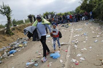 Migrants cross the border from Serbia into Croatia near the village of Babska