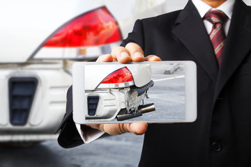 Hand holding smart phone with photo car accident for insurance