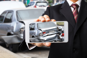 Sale man show picture of car accident on road for insurance