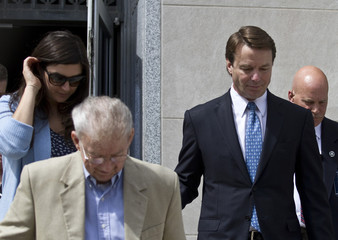 Former U.S. Senator John Edwards exits the courtroom with his daughter and his father after a jury began deliberations in his trial in North Carolina
