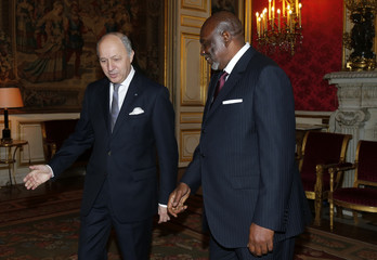 French Foreign Minister Fabius welcomes Mali's Prime Minister Cheick Modibo Diarra before a meeting at the Quai d'Orsay Ministry in Paris