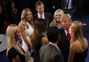 Republican U.S. presidential nominee Donald Trump speaks with his family after the third and final 2016 presidential campaign debate at UNLV in Las Vegas