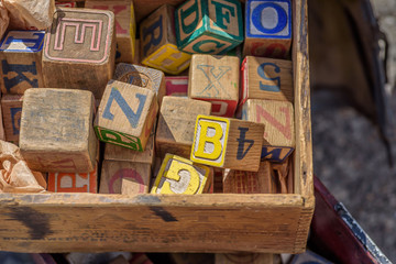 vintage toy wood blocks with letters and numbers
