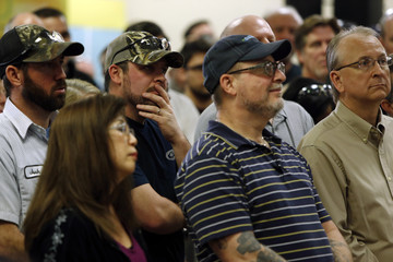 Workers listen to Bush at a town hall meeting with employees at FN America gun manufacturers in Columbia, South Carolina