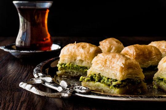 Turkish Dessert Baklava with tea on silver tray.