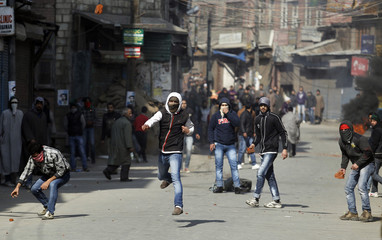 Kashmiri protesters throws pieces of bricks towards Indian police during a clash in Srinagar