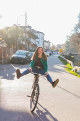 Young woman outdoor cycling enthusiam