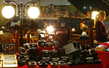 Old cameras are displayed for sale at a market in central Porto Alegre during the 2014 World Cup