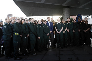 Prince Harry poses with medical staff for a photograph at the London Ambulance Service in central London