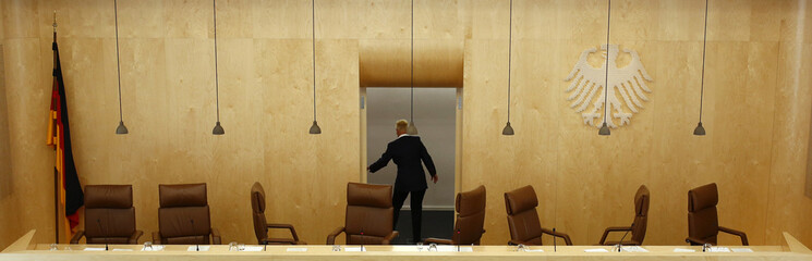 Court usher closes the door of empty courtroom following verdict on ESM at Germany's Constitutional Court  in Karlsruhe