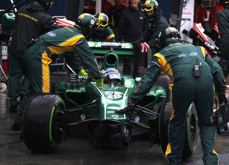 Caterham Formula One driver Pic arrives back at his garage during the qualifying session of the Australian F1 Grand Prix in Melbourne