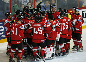 Austria's players celebrate their win over Slovakia after their 2013 IIHF Ice Hockey World Championship preliminary round match at the Hartwall Arena in Helsinki