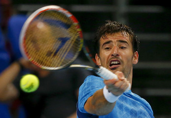 Croatia's Dodig returns the ball during his match against Chiudinelli of Switzerland at the Swiss Indoors ATP tennis tournament in Basel