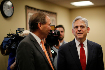 Supreme Court nominee Merrick Garland, chief judge of the D.C. Circuit Court, talks with Senator Tom Udall (D-NM) during a meeting at Hart Senate Office Building in Capitol Hill in Washington, U.S.