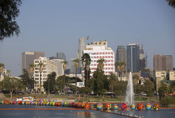 """Inflated spheres are pictured in MacArthur Park Lake, with the downtown skyline in the background, during the installation of Portraits of Hope's exhibition """"Spheres at MacArthur Park"""" in Los Angeles"""