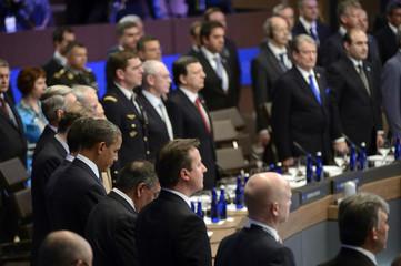 NATO leaders observe a minute of silence for NATO troops injured or killed as heads of state and government attend the North Atlantic Council meeting during the NATO Summit in Chicago