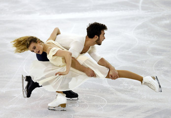 Gabriella Papadakis and Guillaume Cizeron of France perform during ice dance skating event at the ISU Grand Prix of Figure Skating final in Barcelona