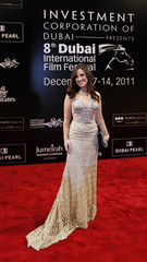 Egyptian actress Adel poses as she arrives for the 8th Dubai International Film Festival