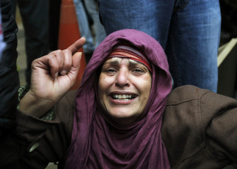 An Egyptian woman reacts to the situation in her homeland during a demonstration against Egypt's President Hosni Mubarak in Amman