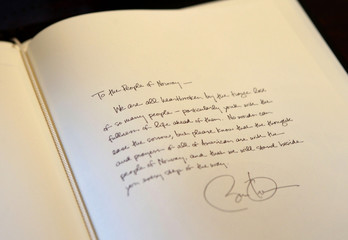 A message left by US President Obama is seen in a book of condolence at the Norwegian Embassy in Washington