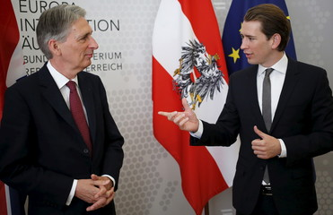Austrian Foreign Minister Kurz and Britain's Foreign Secretary Hammond address the media after a meeting in Vienna