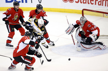 Boston Bruins Marchand tries to get past the Ottawa Senators players during the first period of their NHL hockey game in Ottawa