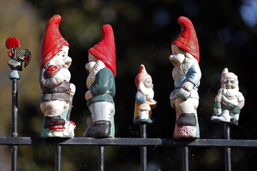 Garden gnomes are seen on the fence of a house in Chateau Thierry