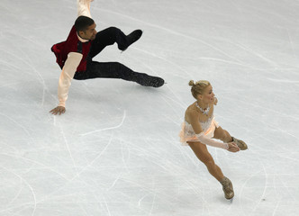 Aliona Savchenko and Robin Szolkowy during pairs free skating at the Sochi 2014 Winter Olympics