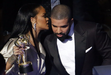 Drake speaks with Rihanna during the 2016 MTV Video Music Awards in New York