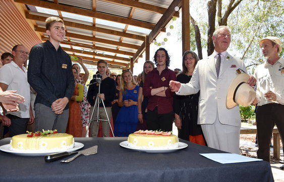 Britain's Prince Charles prepares to cut a birthday cake during a visit to Oranje Tractor Wines in Albany