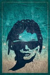Portrait of beautiful woman in black sunglasses. Short hair. Front view, Grunge concrete texture