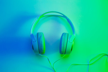 Headphones on vibrant colorful background - poster