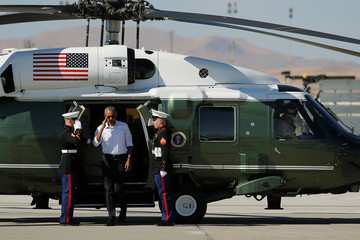Obama arrives aboard the Marine One helicopter to board Air Force One to depart for Hawaii, on his way to tour Midway Atoll and attend summits in Laos and China, from Reno-Tahoe International Airport in Reno, Nevada, U.S.