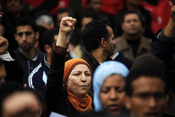 Protester gestures during a demonstration in downtown Tunis