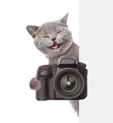Cat taking a picture behind a placard. isolated on white background