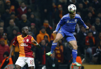 Chelsea's Hazard jumps for the ball past Galatasaray's Eboue during their Champions League soccer match at Turk Telekom Arena in Istanbul