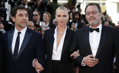 """Cast members Charlize Theron, Jean Reno, and Javier Bardem pose on red carpet as they arrive for the screening of the film """"The last Face"""" in competition at the 69th Cannes Film Festival in Cannes"""